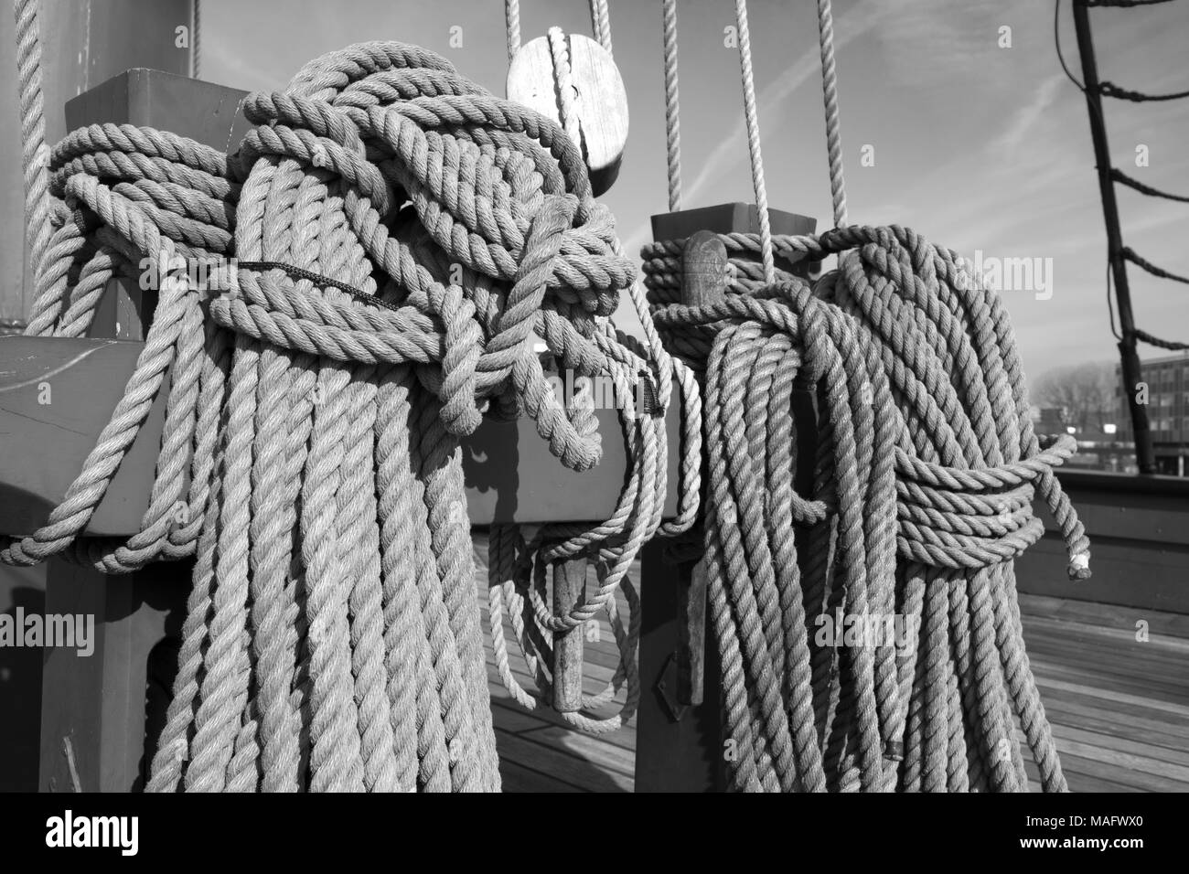 Ropes, pulley, shroud - parts of an old ship, sailboat. Black and white photo, high resolution. - Stock Image