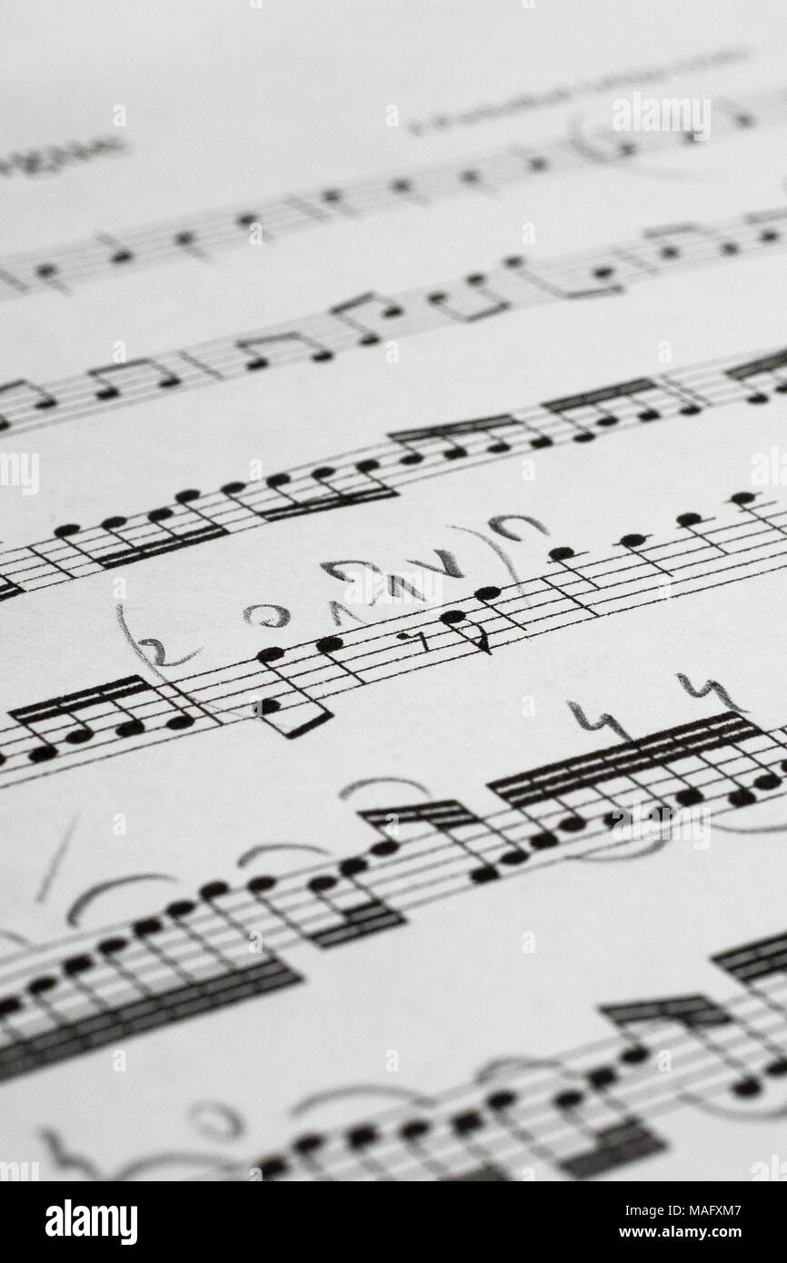 Song notes on staff sheet with pencil marks, vertical frame - Stock Image