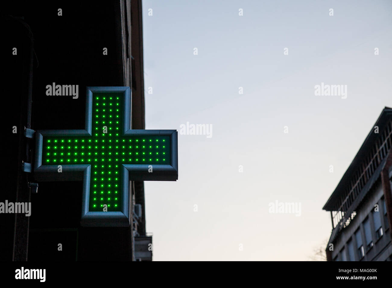 Pharmacy Green Cross Lit With Neon And Led Lights In Sunset This