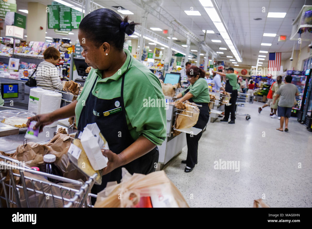 Miami Beach Florida Publix Super Market supermarket grocery store business shopping groceries checkout lane Black woman cashier - Stock Image