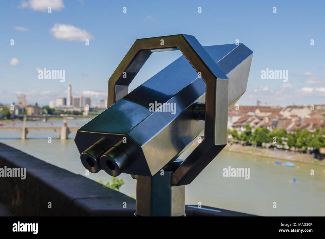BASEL, SWITZERLAND - JUNE 04 2017: telescope against the backdrop of the city of Basel. Switzerland. Europe. - Stock Image