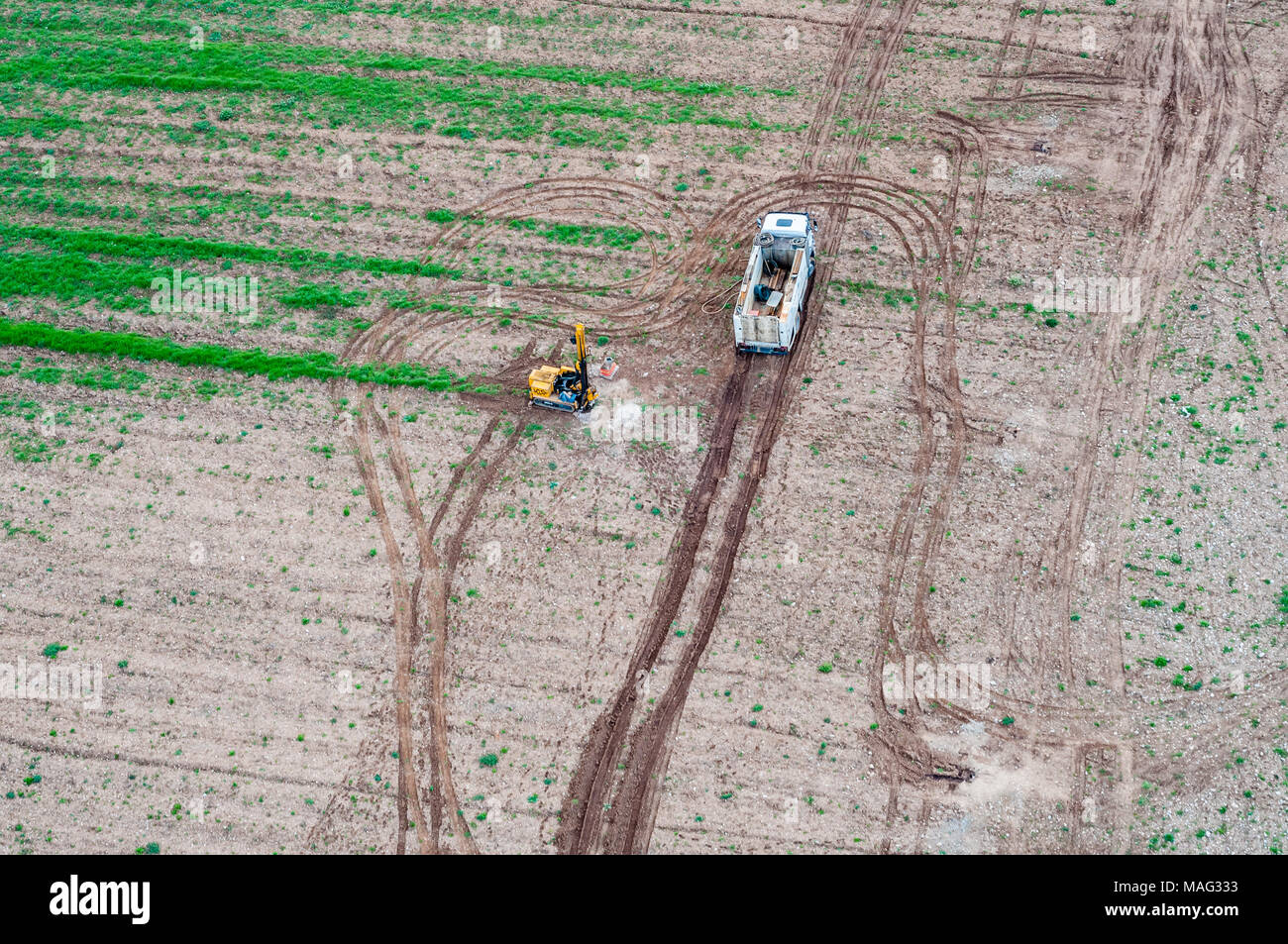 aerial view, survey work for geotechnical study, field, soil core, soil report - Stock Image