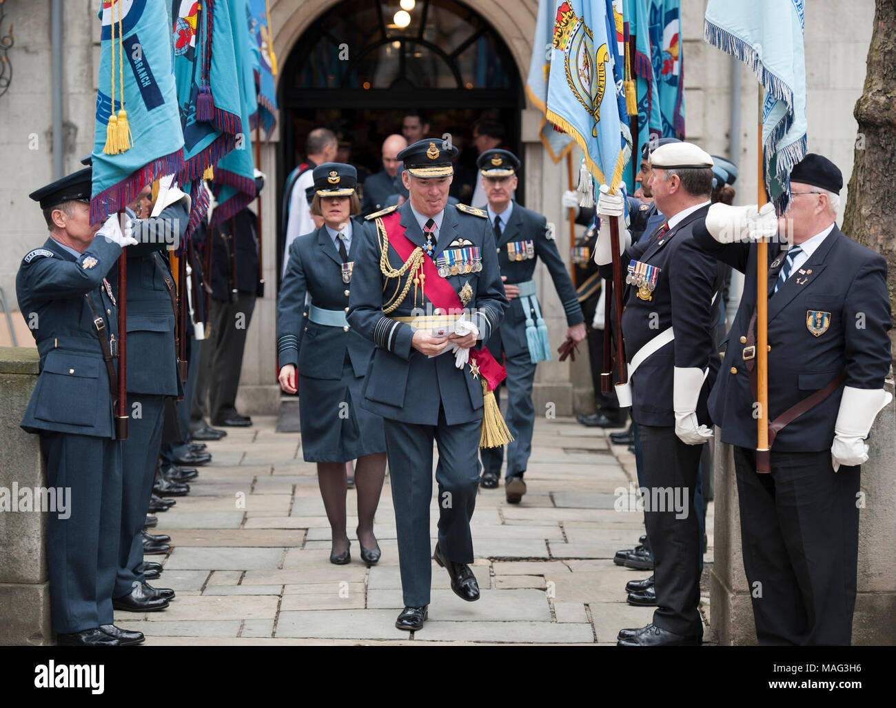Serving and former RAF Officers leave St Clement Danes Church on The Strand in London, 1 April 2018. - Stock Image