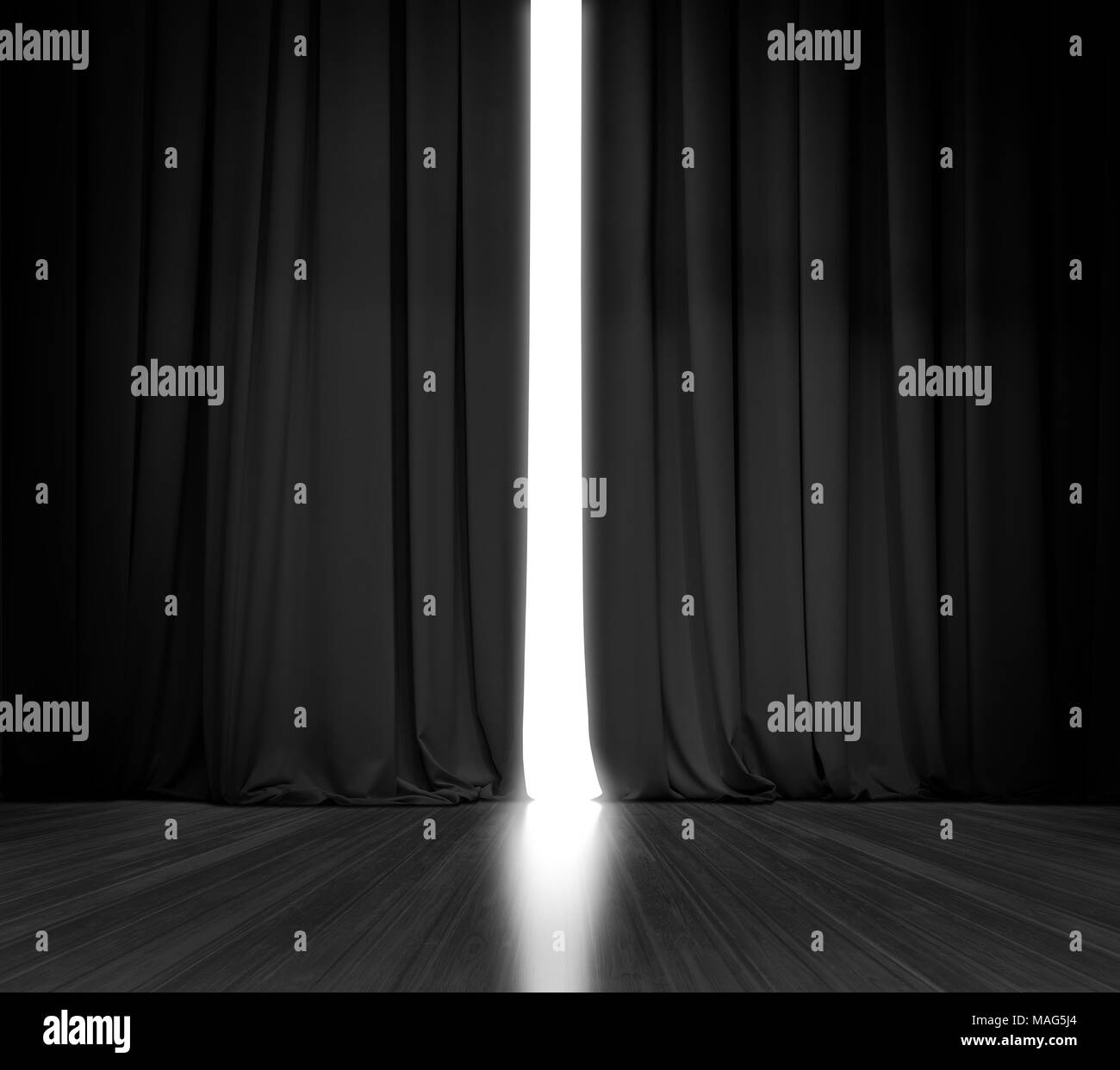 Black curtain background with bright light behind Stock Photo