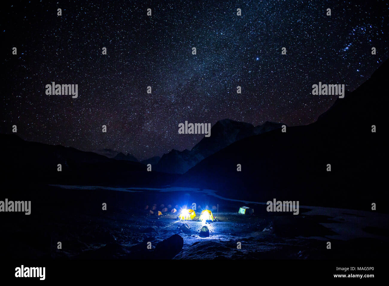 A stunning view of stars and Milky Way galaxy above a campsite near base camp Everest, Nepal - Stock Image