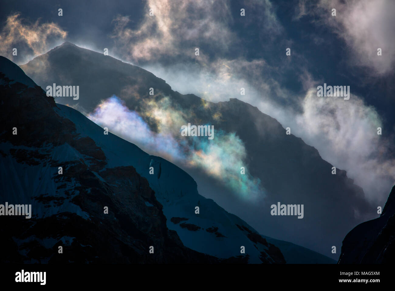 The peak of Mt. Everest shrouded in threatening clouds during early morning.  Nepal - Stock Image