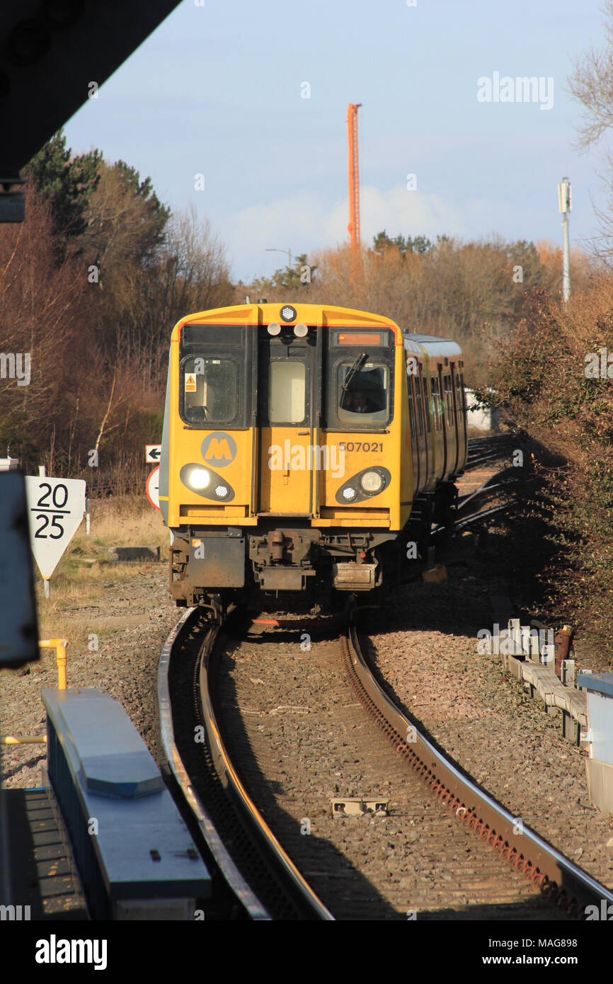 An electric train on the Merseyrail suburban railway from Kirkby arrives at the station at Sandhills. Stock Photo
