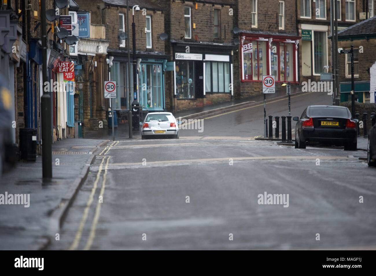 New Mills. High Peak. Derbyshire. 2nd April 2018. UK Weather: A wet and deserted  main street in New Mills on Easter Monday morning. Credit: John Fryer/Alamy Live News - Stock Image