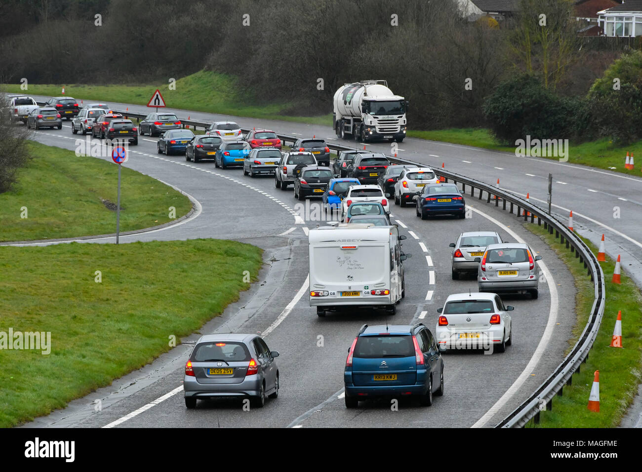 Honiton, Devon, UK. 2nd April 2018. Holidaymakers queuing in a traffic jam on the East bound carriageway on the A30 at Honiton in Devon on Easter Monday as they return home from their Easter weekend holidays.  Picture Credit: Graham Hunt/Alamy Live News - Stock Image