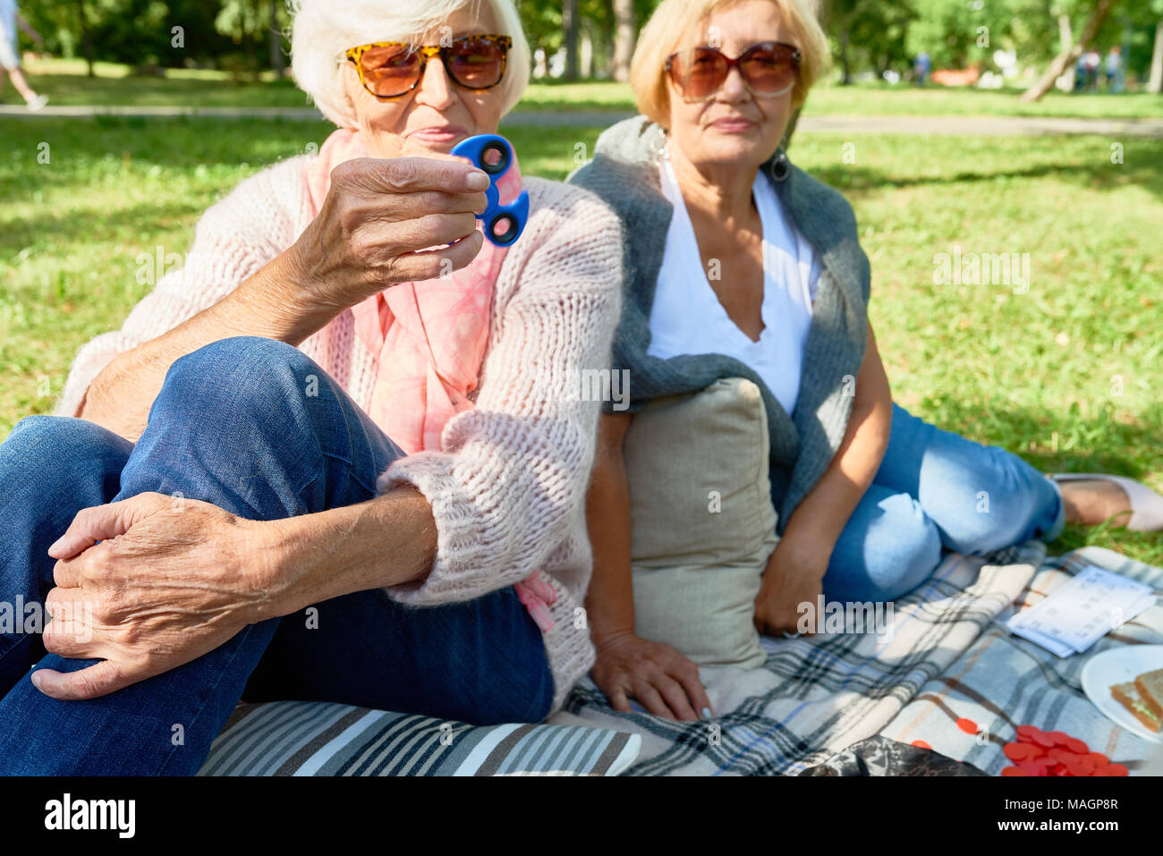 Senior Woman with Spinner - Stock Image