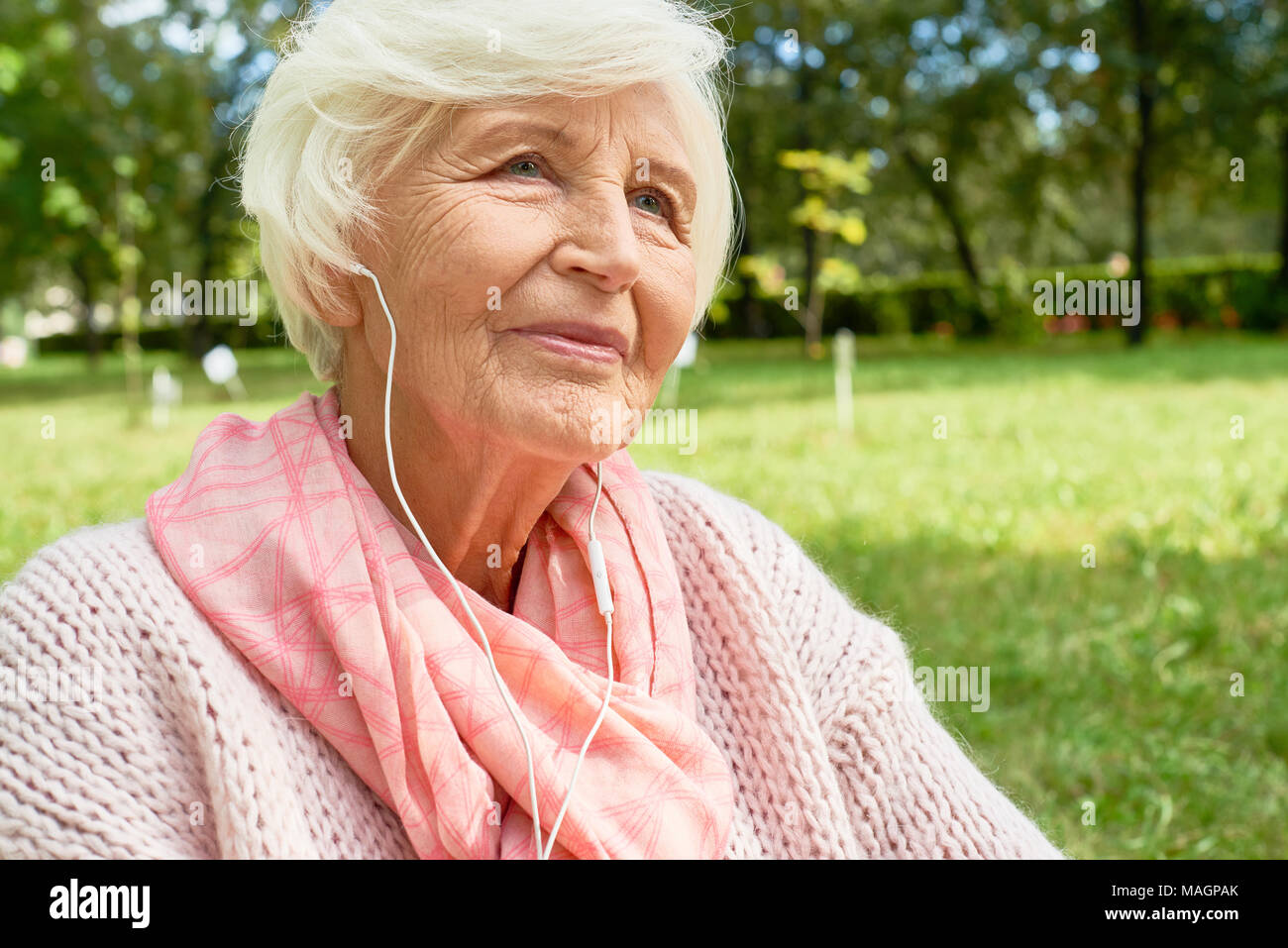 Senior Woman Enjoying Music - Stock Image