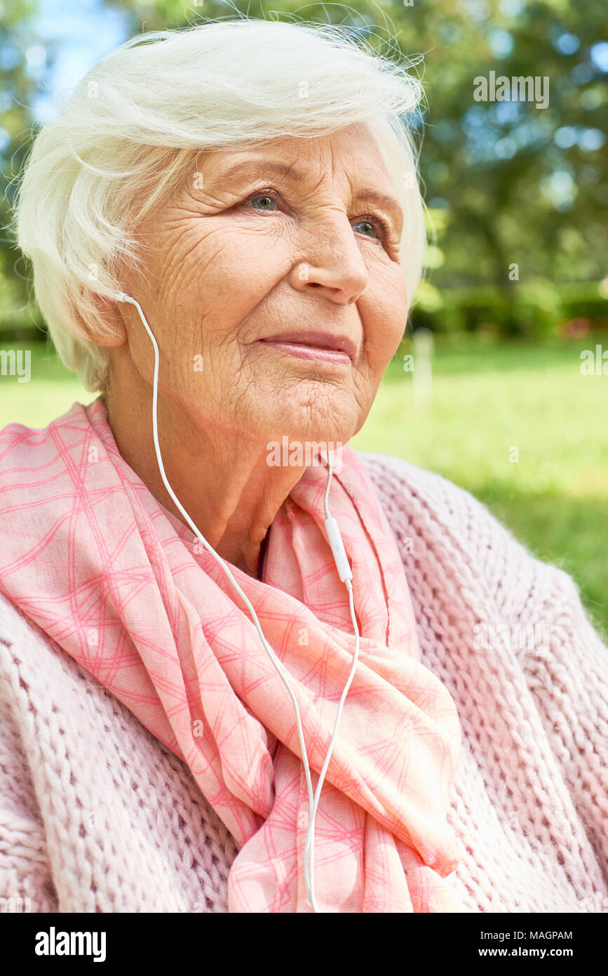 Senior Woman Listening to Music - Stock Image