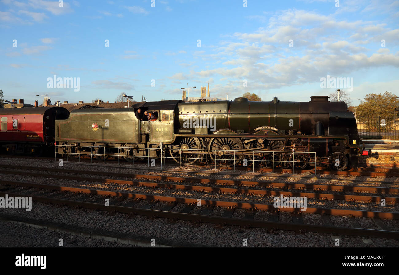 Former LMS Royal Scot class 4-6-0 steam locomotive 46115 'Scots Guardsman' at Lincoln, 9th November 2014. - Stock Image