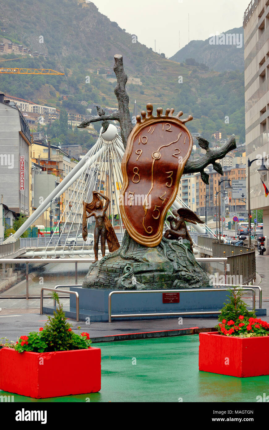 Cityscape with bronze sculpture 'Nobility of Time', located on shopping street in capital city. Andorra la Vella, Andorra - Stock Image