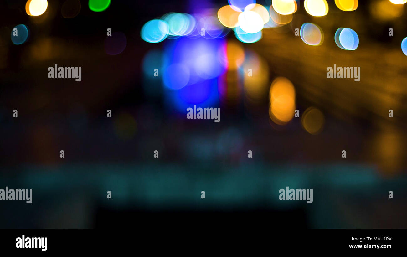 Out of focus background with blurry unfocused lights. Video. Color Blurred background : Bokeh lighting in city night light blur bokeh. Floodlights. Concert stage flash lights. - Stock Image