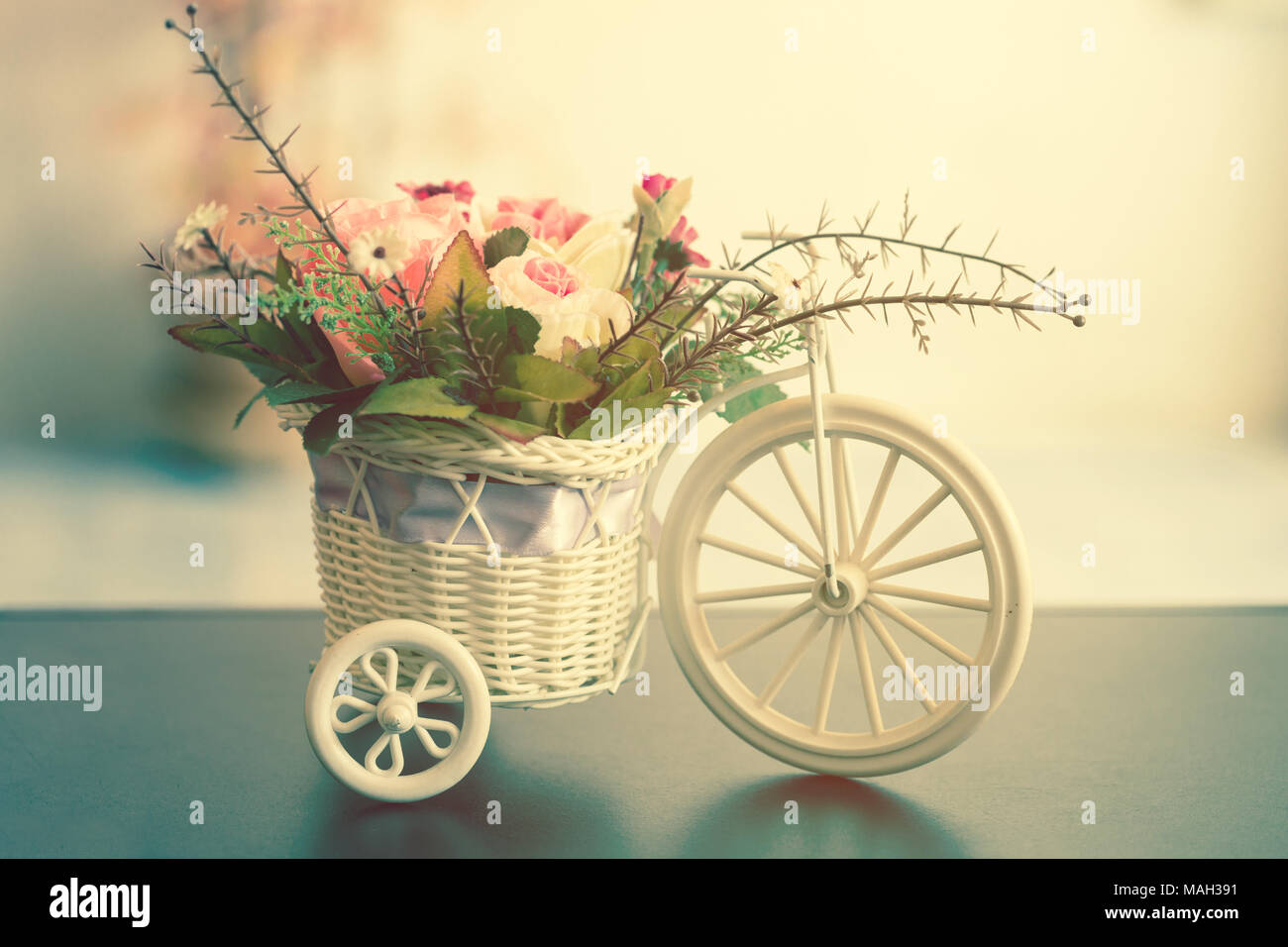 Artificial flowers in a white bicycle basket on black table artificial flowers in a white bicycle basket on black table vintage style mightylinksfo