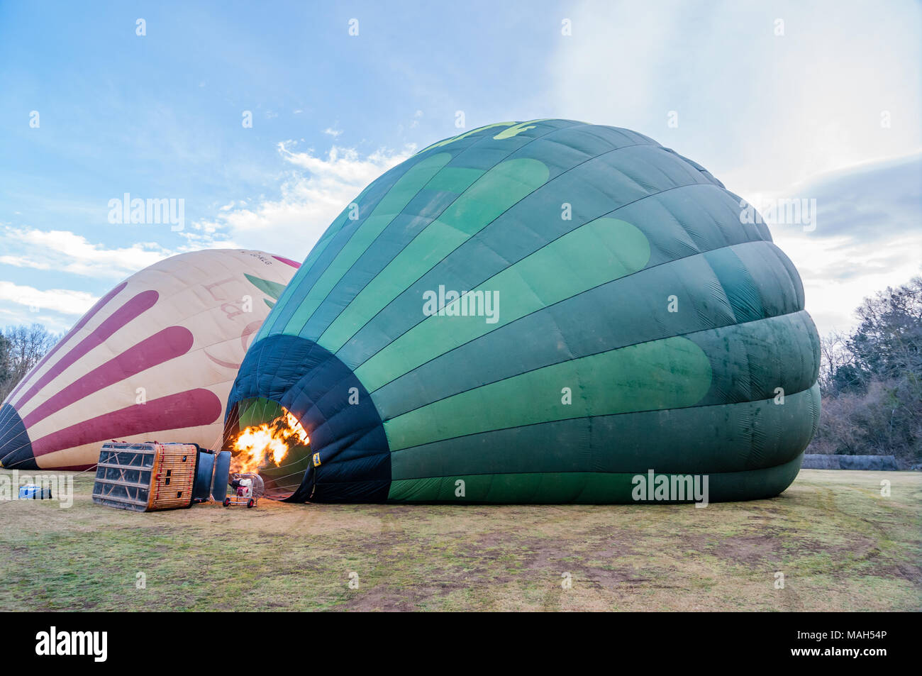 blowing hot air in a hot air balloon, inflating, wicker basket, Catalonia, Spain - Stock Image