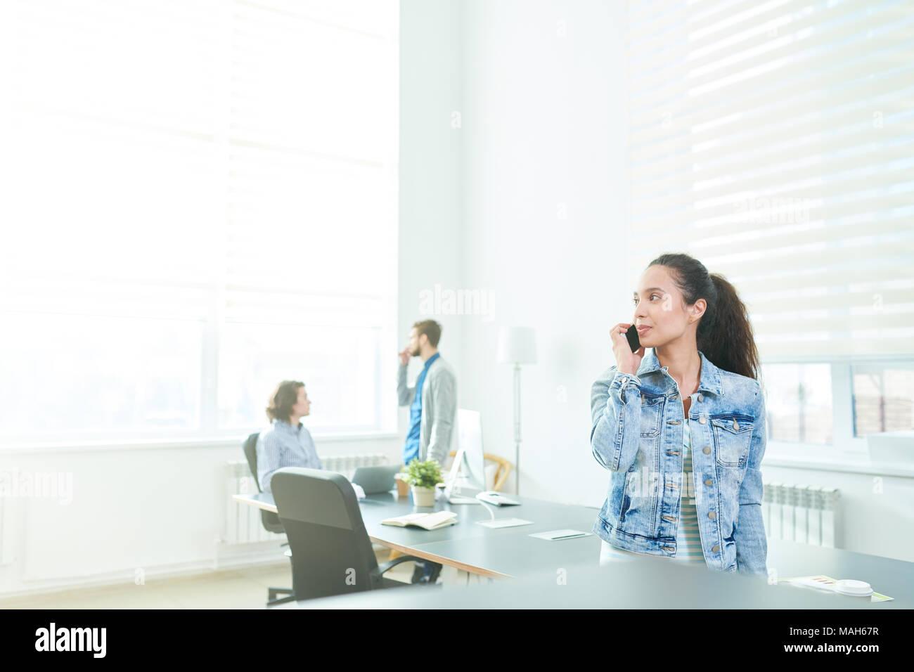 Purposeful business lady speaking on phone - Stock Image