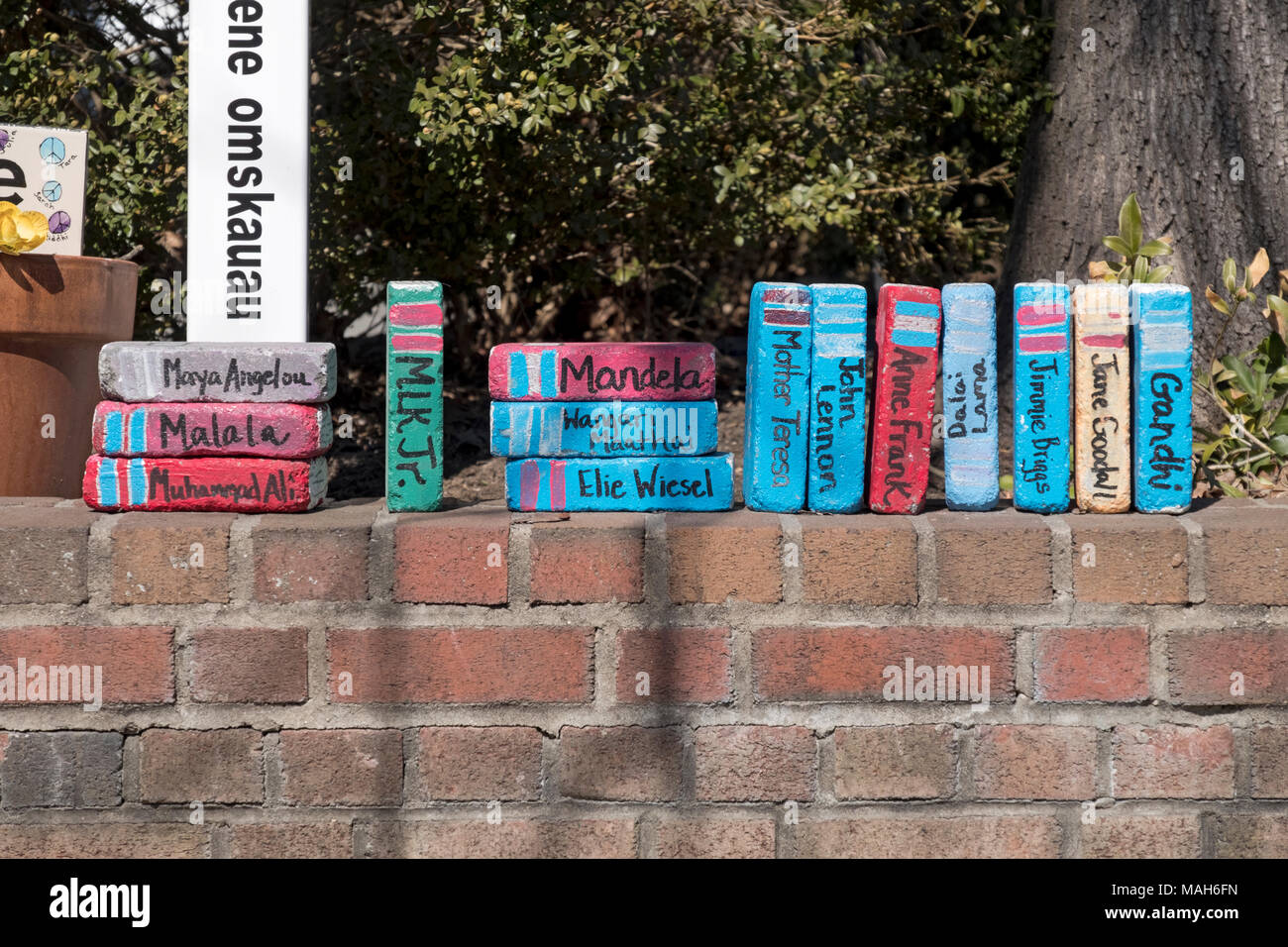 Clever decoration outside Scattered Books in Chappaqua where bricks were colorfully painted to look like books. - Stock Image