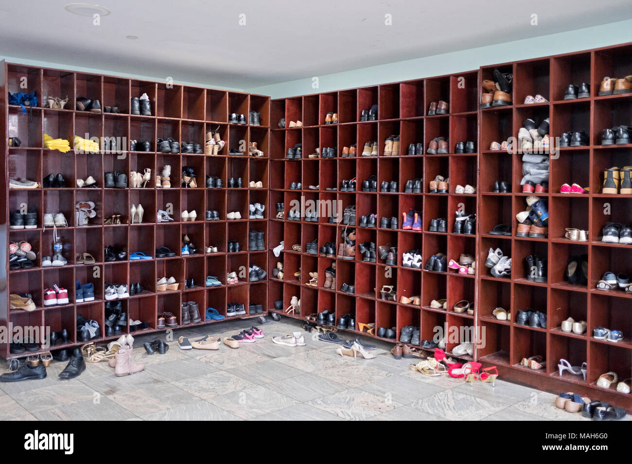 The cubicles for storing shoes and socks at the Sikh Cultural Center in Richmond Hill, Queens New York. The items are not worn in the temple. - Stock Image