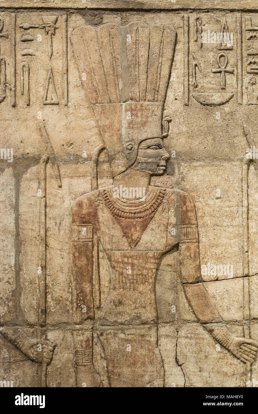 Oxford. England. Shrine of King Taharqa (690–664 BC), detail of goddess Anukis (Anuket), Ashmolean Museum.   Detail of bas-relief on the west wall of  - Stock Image