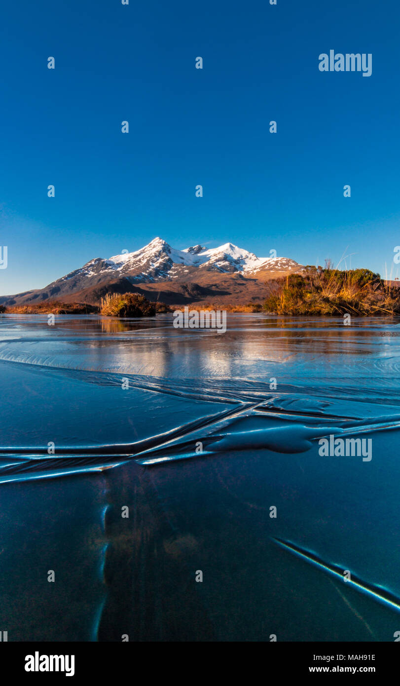 Frozen Reflections of the Cuillin Ridge, Isle of Skye - Stock Image