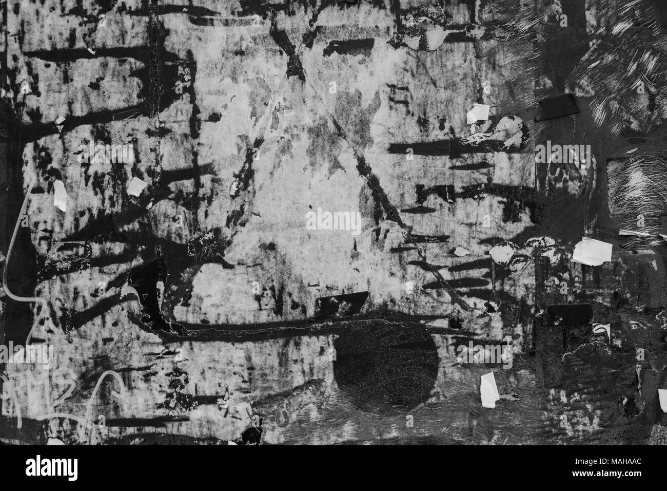 black and white textured bulletin board with paper remnants. - Stock Image