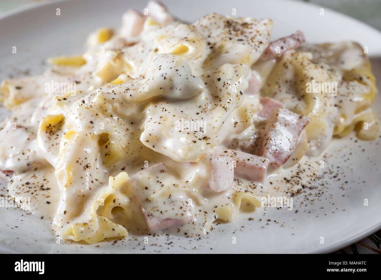 Tortellini And Ravioli With Smoked Ham And Mushrooms And Sour Cream Sauce Stock Photo Alamy