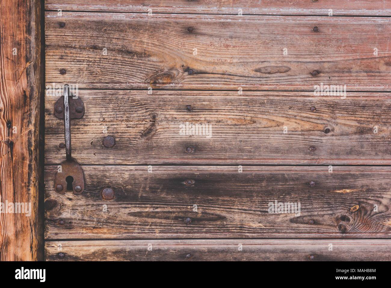 Metallic handle of door is in an old house - Stock Image