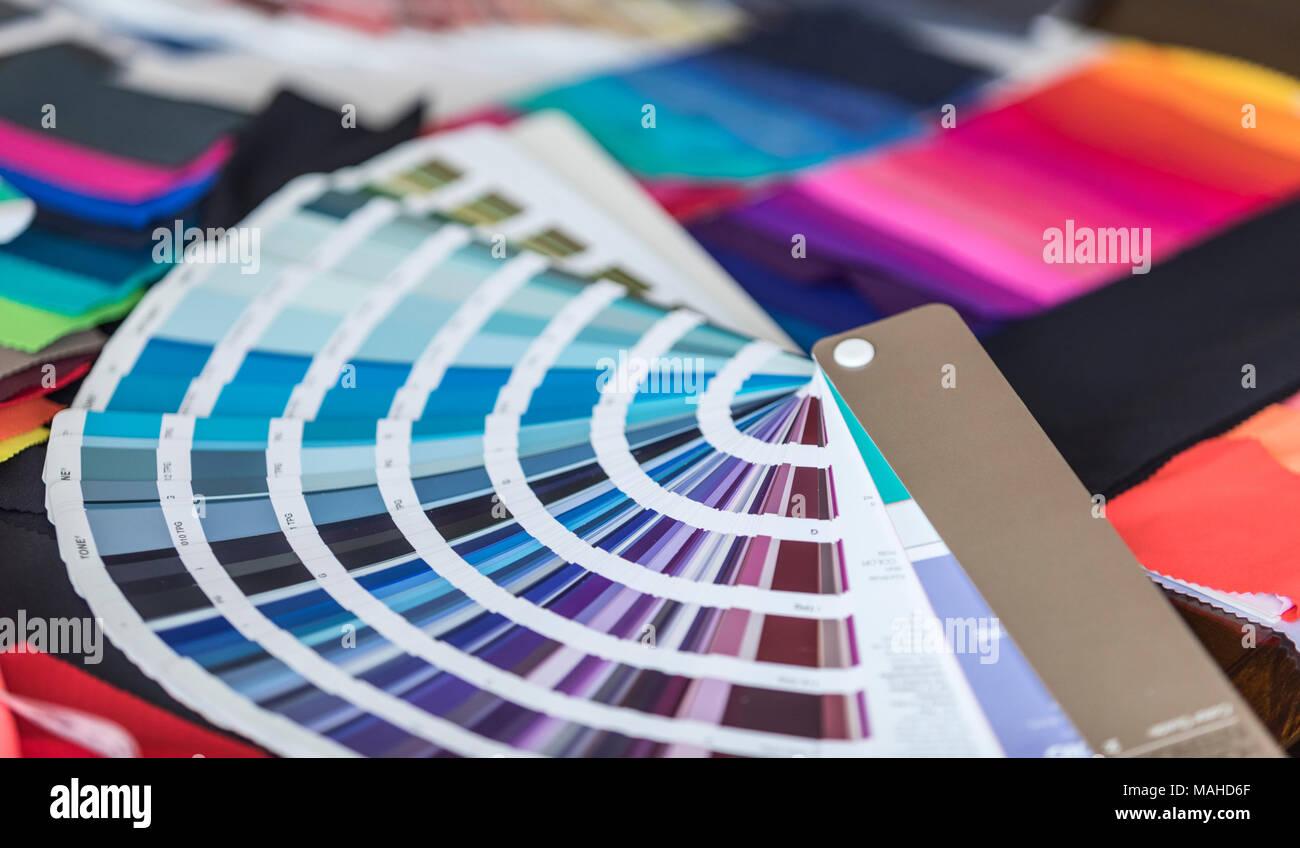 Pantone Books and Colourful Fabrics - Stock Image