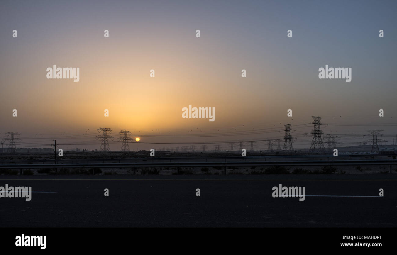 Silhouette of high voltage power lines in Dubai Stock Photo