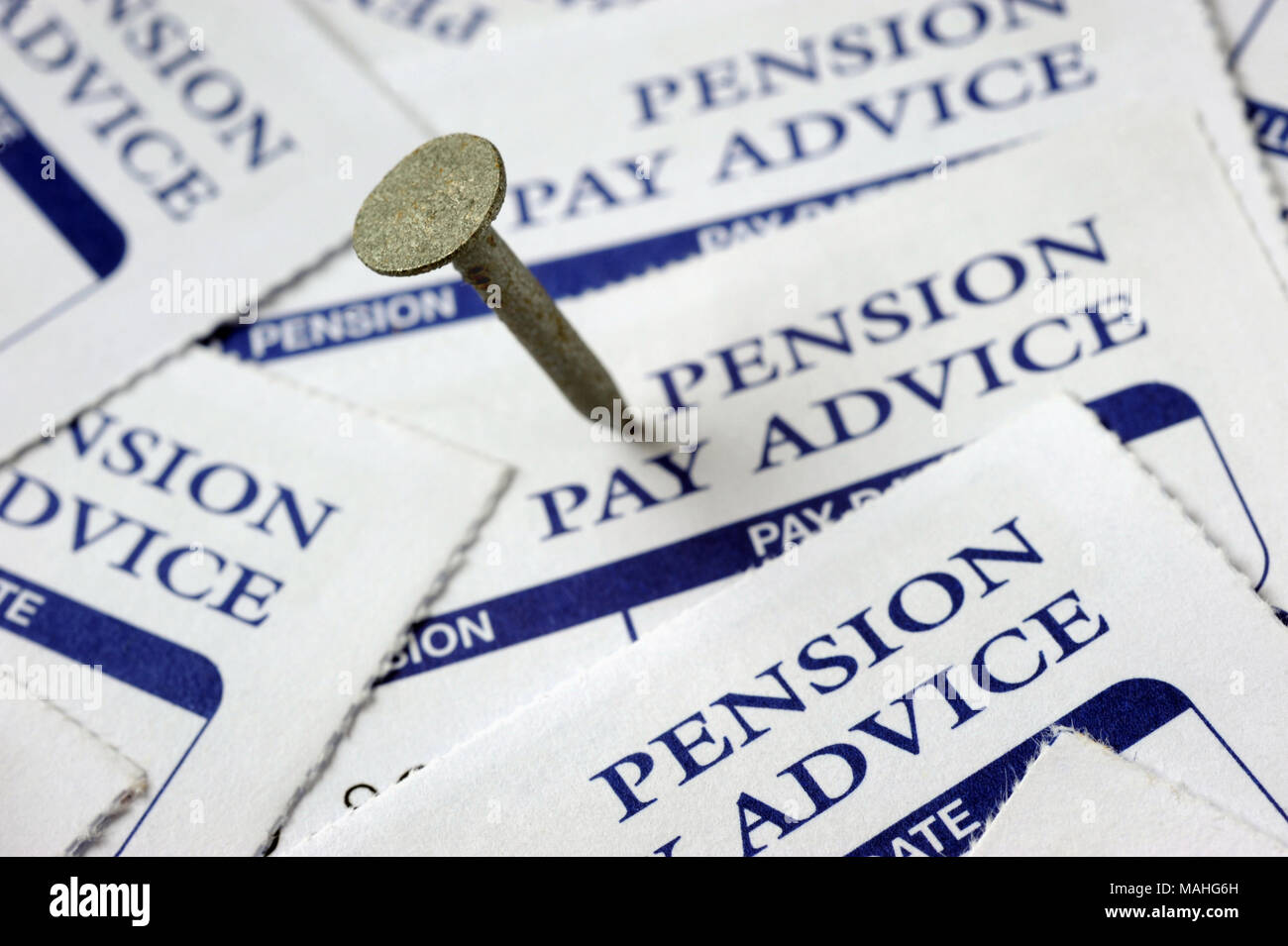 NAIL IN PENSION PAY ADVICE SLIPS RE COMPANY PENSIONS PRIVATE PENSIONS PENSIONERS ETC UK - Stock Image