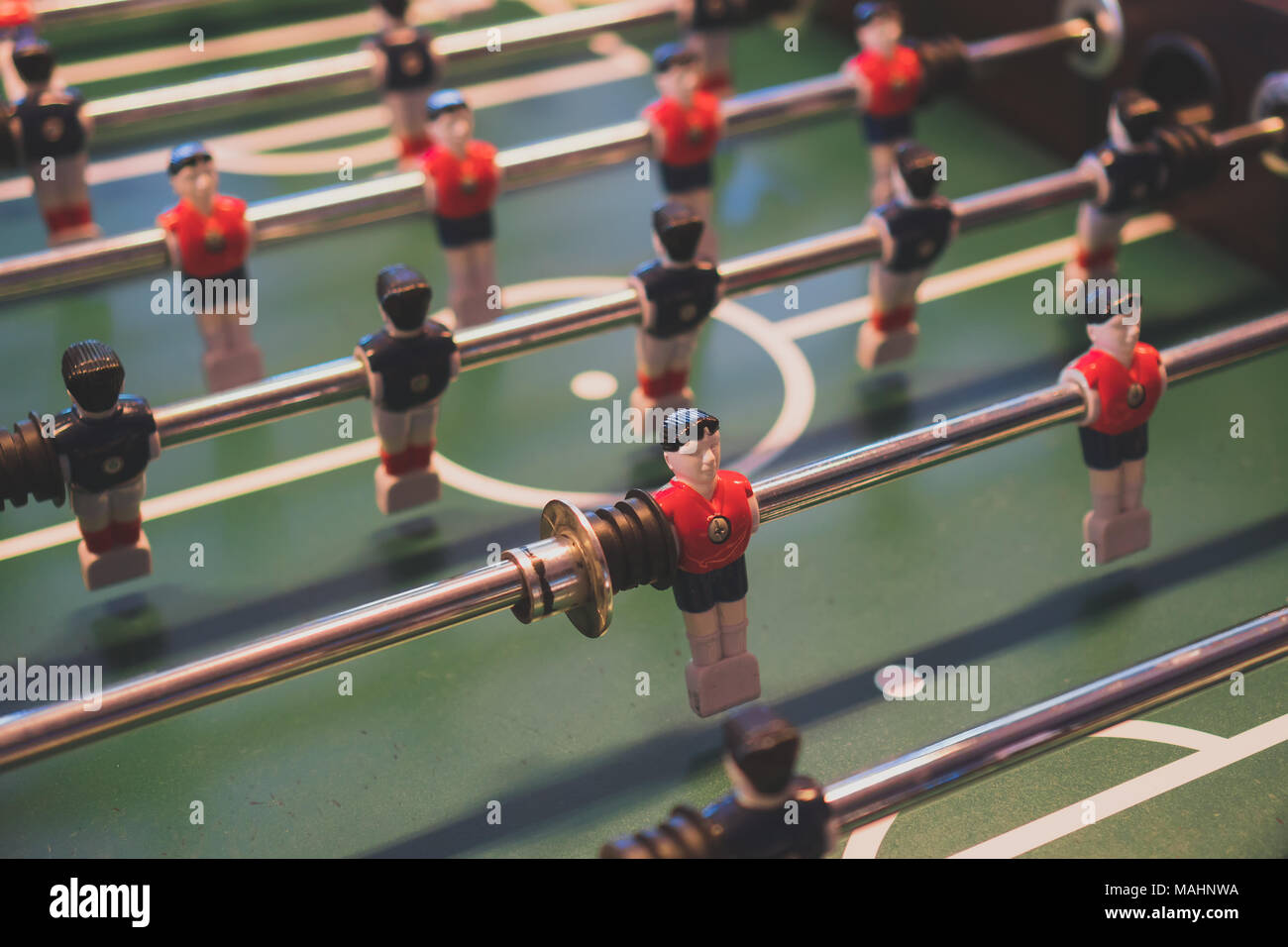 Table football game with red and blue players. - Stock Image