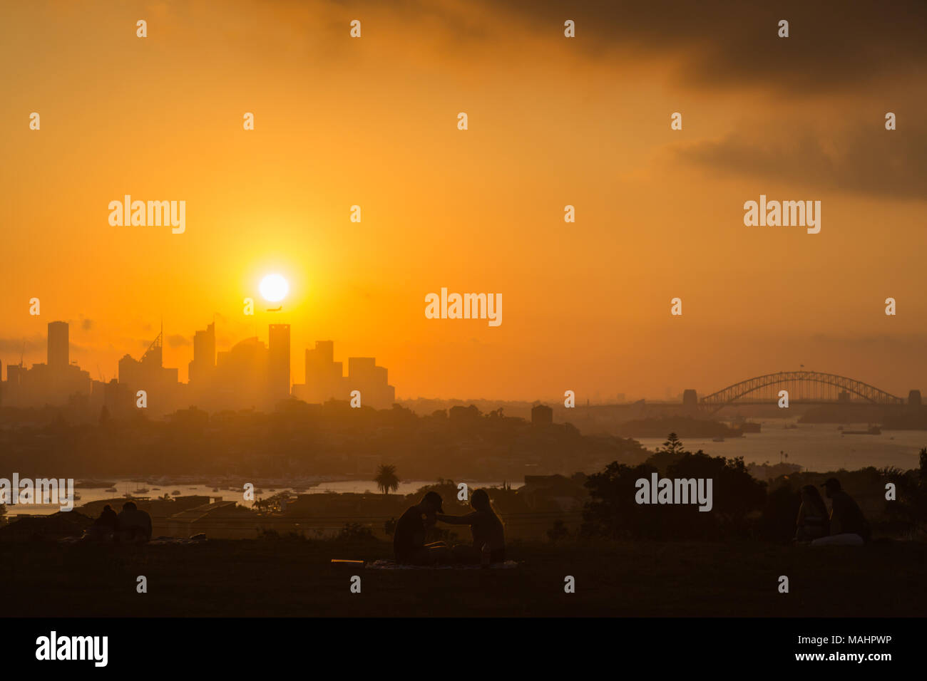 A dramatic sunset at Dudley Page Reserve, Eastern Suburbs, Sydney. Great views of the Sydney Skyline at sunset. - Stock Image