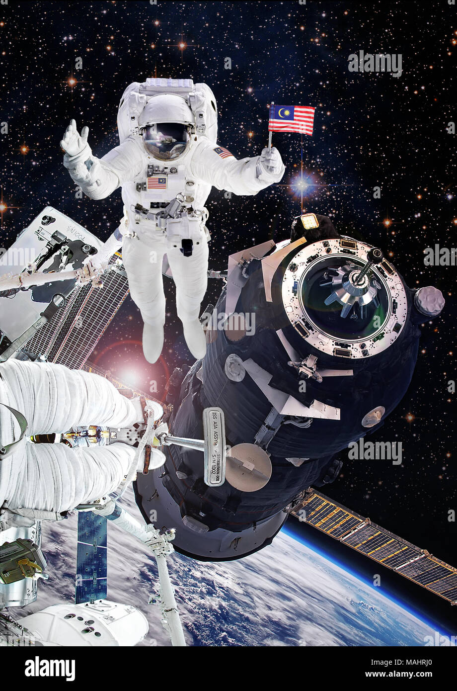 Astronaut in outer space, artist expression of Malaysia National Space Agency cosmonaut on International Space Station. Elements of this image furnish Stock Photo