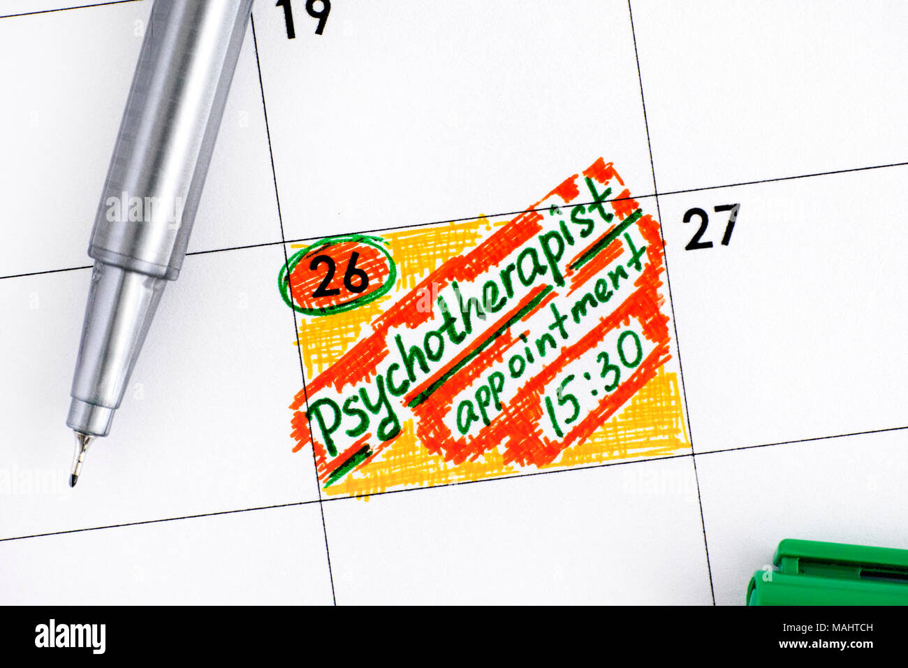 Reminder Psychotherapist Appointment in calendar with green pen. - Stock Image