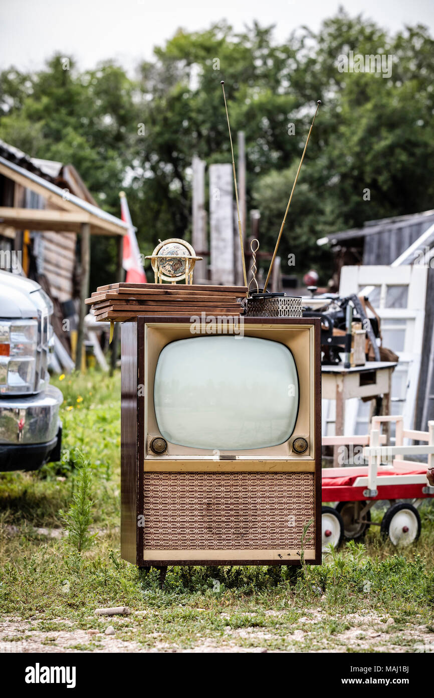 Vintage tube television with rabbit ears at an outdoor flea market, Manitoba, Canada. - Stock Image