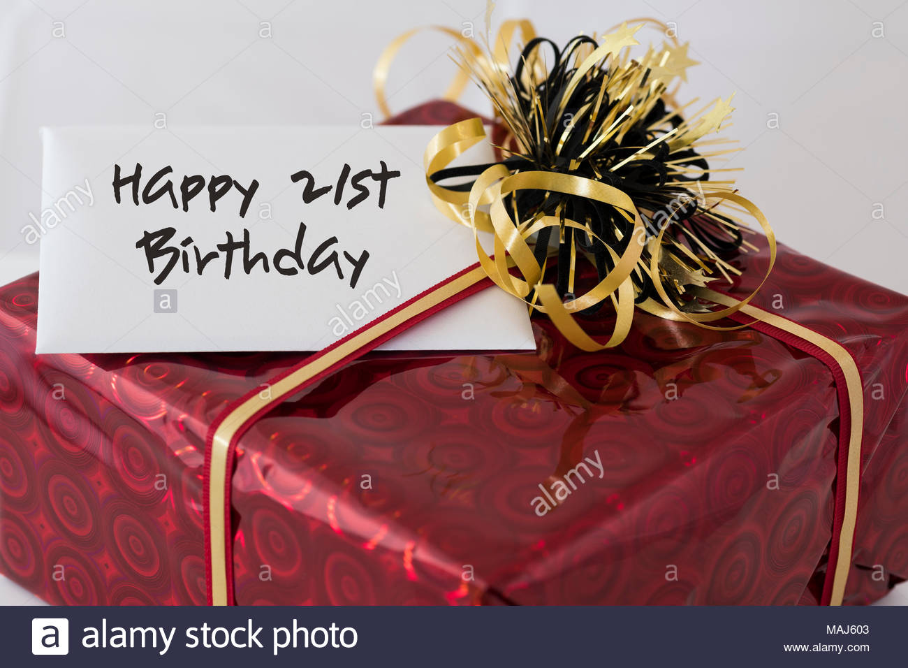 Wrapped Present With The Wording Happy 21st Birthday Written On Gift Tag Dorset England UK