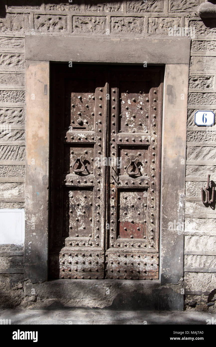 Medieval Door with Graffiti, Florence, Italy - Stock Image