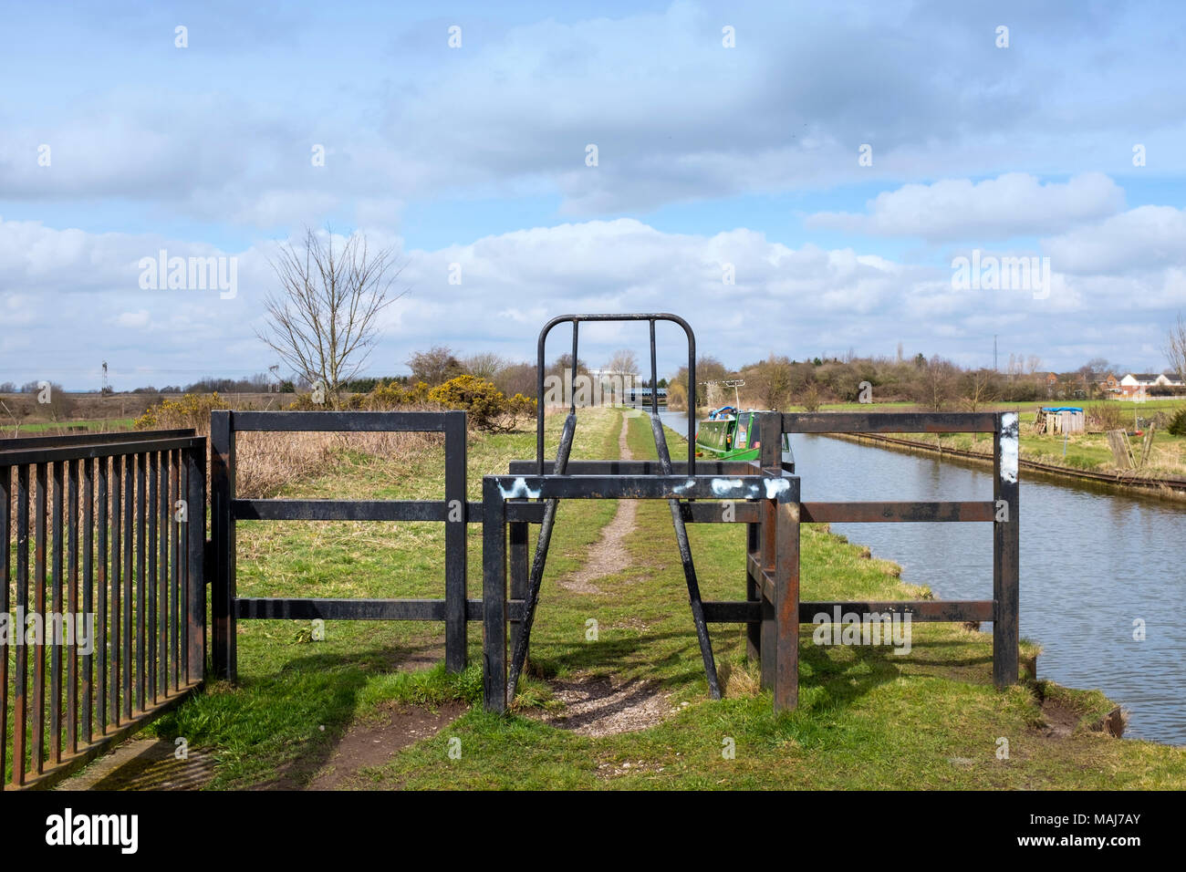 Barrier on towpath limiting vehicle and speed access next to the Trent and Mersey canal in Cheshire UK - Stock Image