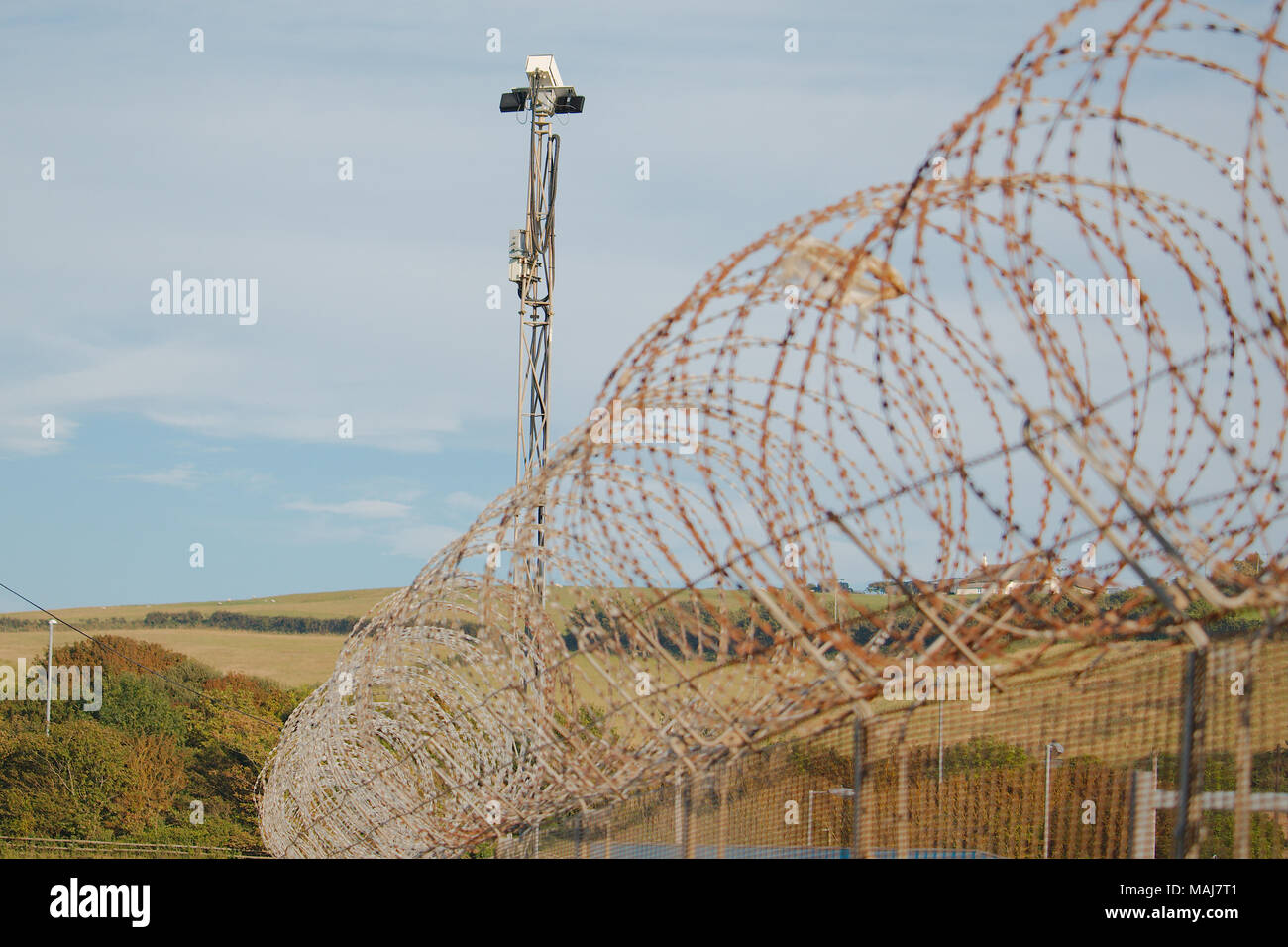 Cctv Camera Barbed Wire Fence Stock Photos & Cctv Camera Barbed Wire ...