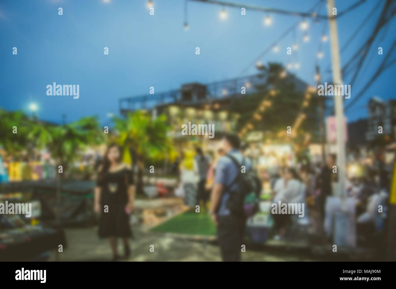 Blur Festival food night market for background usage. - Stock Image