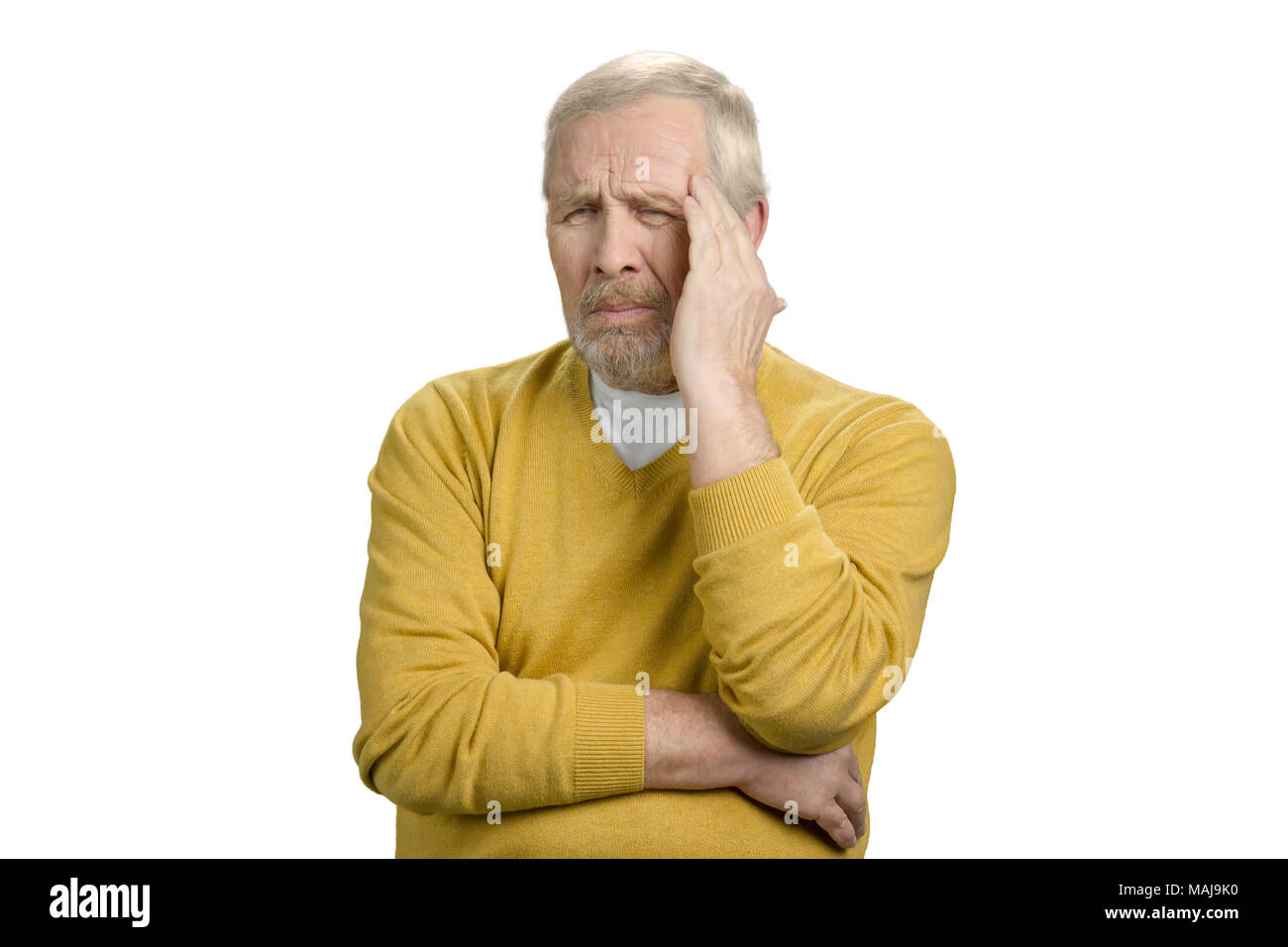 Old senior grandpa having headache. Sad and frustrated man. White isolated background. - Stock Image