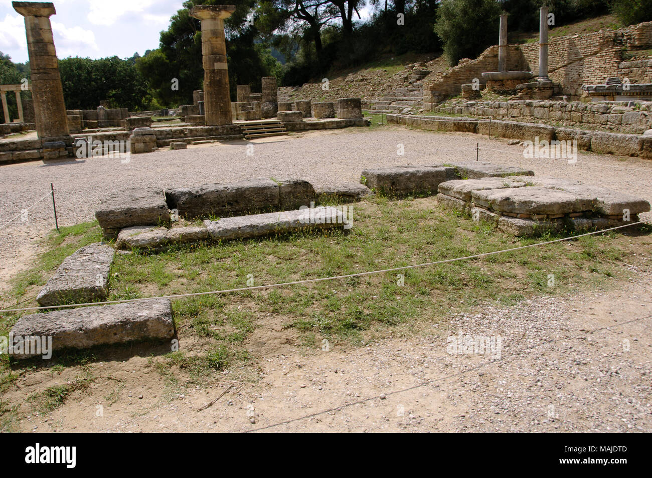 Olympia. Temple of Hera. It was built aound 600 BC. View of the altar. The torch of the Olympic flame is lit in its ruins since 1936. Elis region, Peloponnese, Greece. - Stock Image