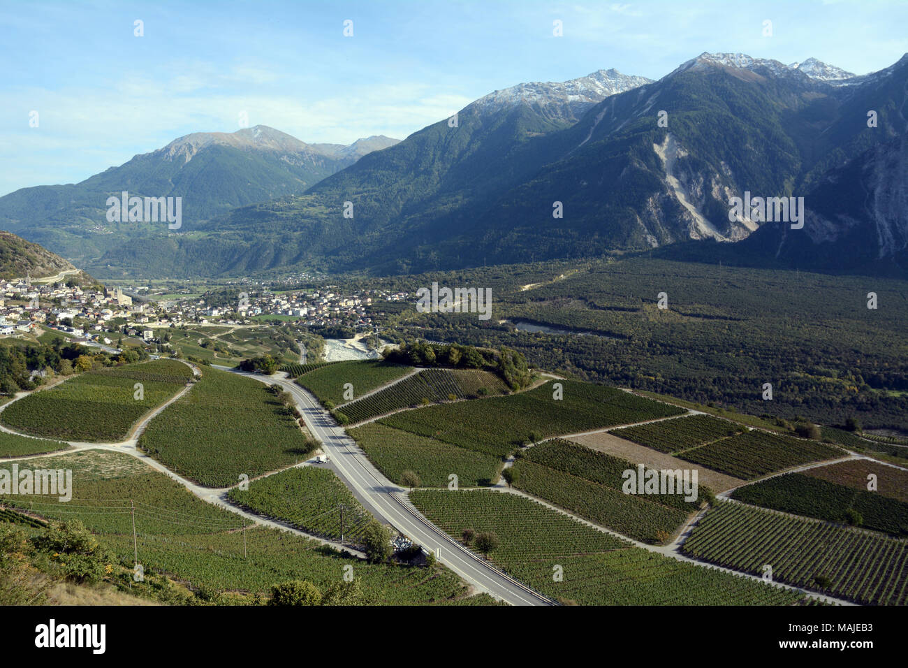 The city of Leuk and vineyards on its edges, seen from the Swiss Wine Trail, in the upper Rhone Valley, canton of Valais, southern Switzerland. - Stock Image