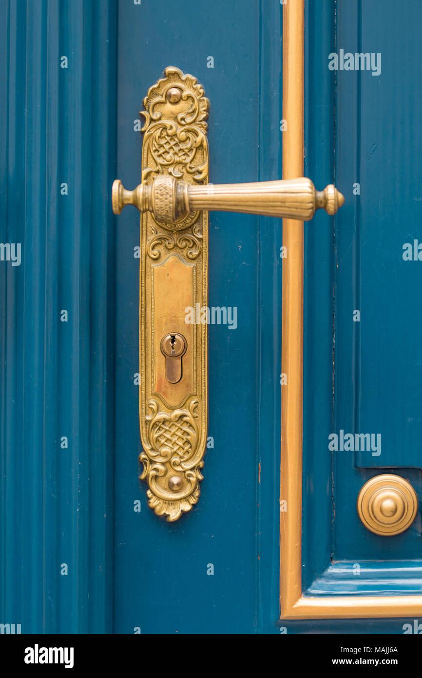 antique ornate gold door handle - Stock Image