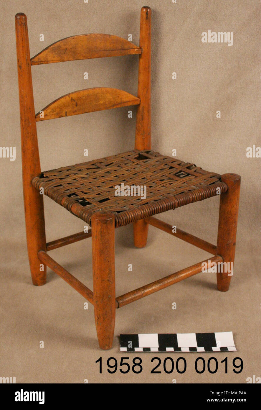 Slat back pine dolls chair with a woven cane seat title pine doll chair circa 1850