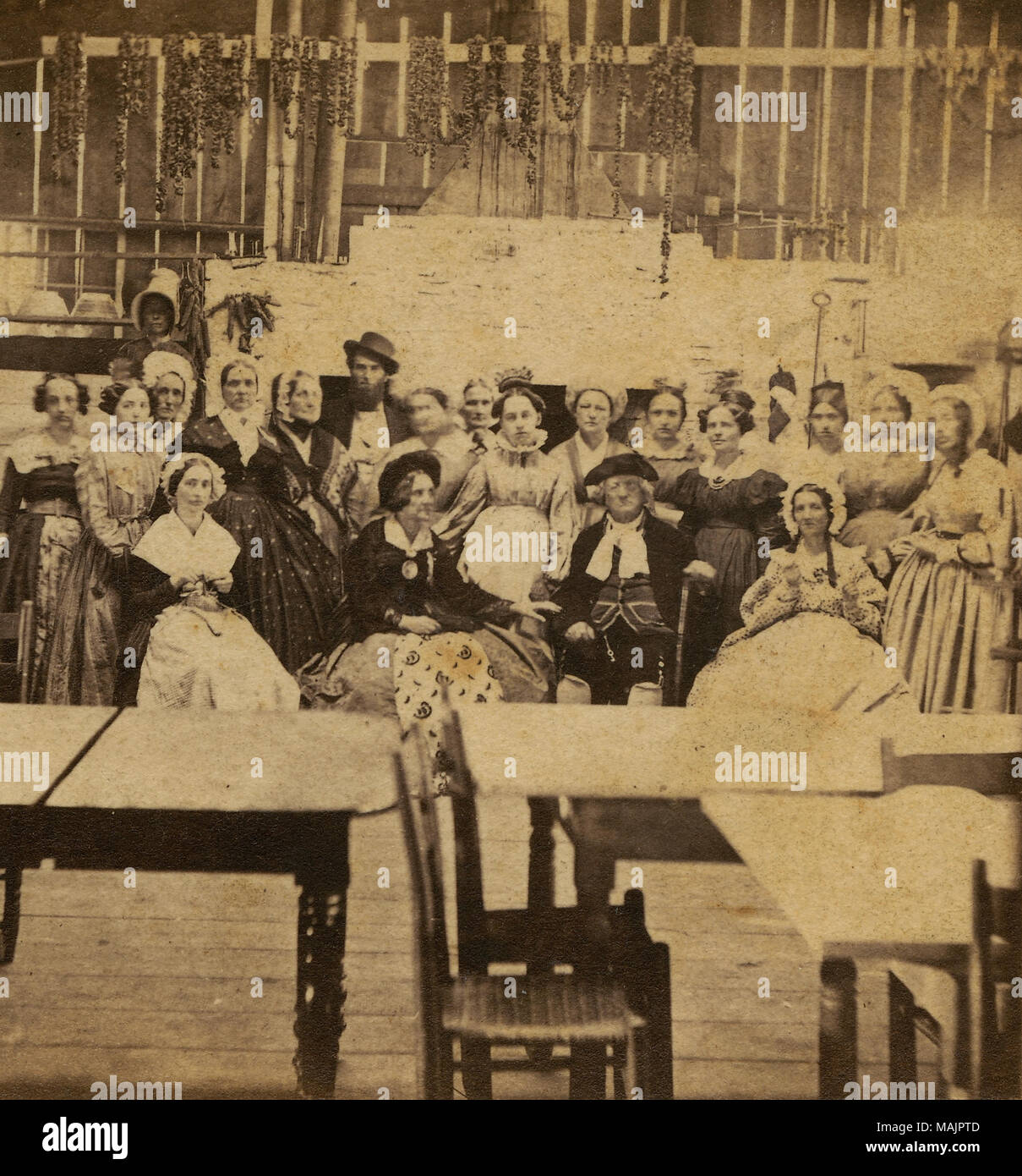 half view stereograph of a group of people in the background and a