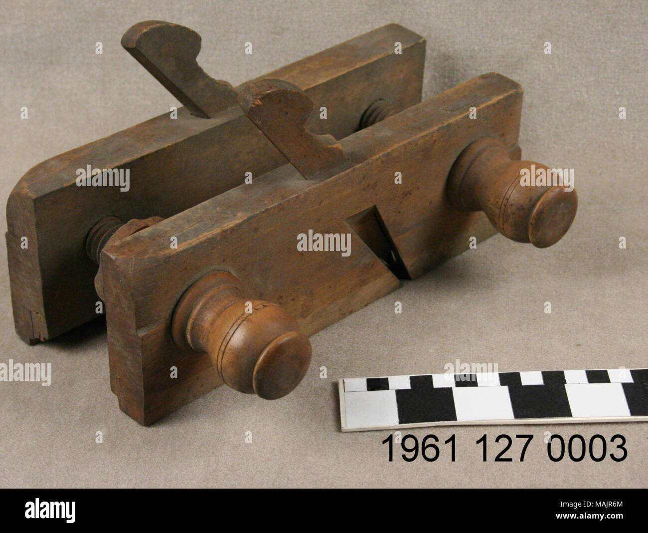 A wooden sash plane with adjustable screw arms. Title: Wooden Adjustable Screw Arm Sash Plane  . circa 1840. John Creagh - Stock Image