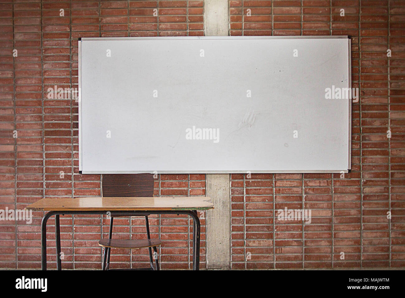Empty Teacher S Desk With Whiteboard In The Background No Teacher No Students Classroom Without Teacher Classroom Without Students University Classroom Adults Education Stock Photo Alamy